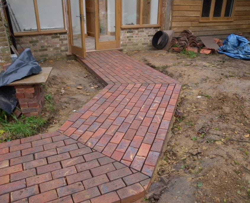 Photo of Diagonal laid red brick path at a garden in East Sussex by Mark Payne Landscape Design
