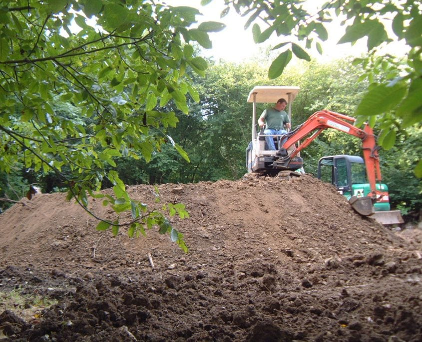 A digger during a garden project management job