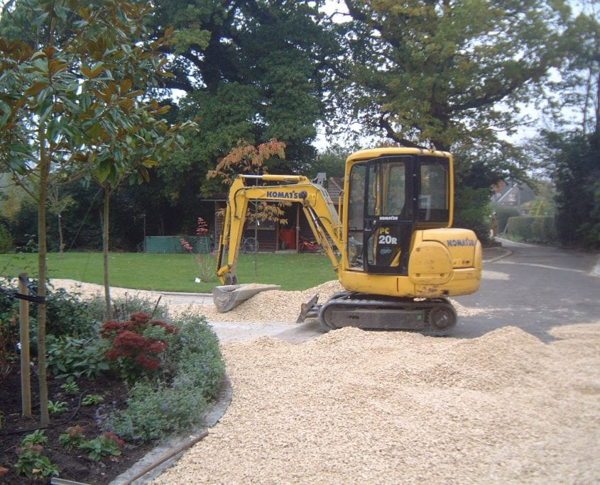 A digger during the garden project management build