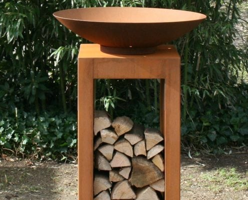 Photo of Corten Steel Fire Bowl on plinth by The Pot Company