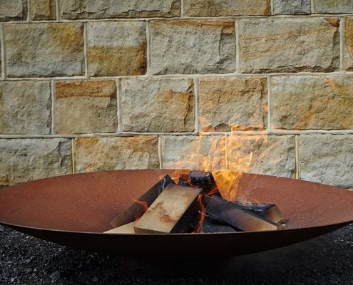 Photo of a corten steel fire bowl by The Pot Company