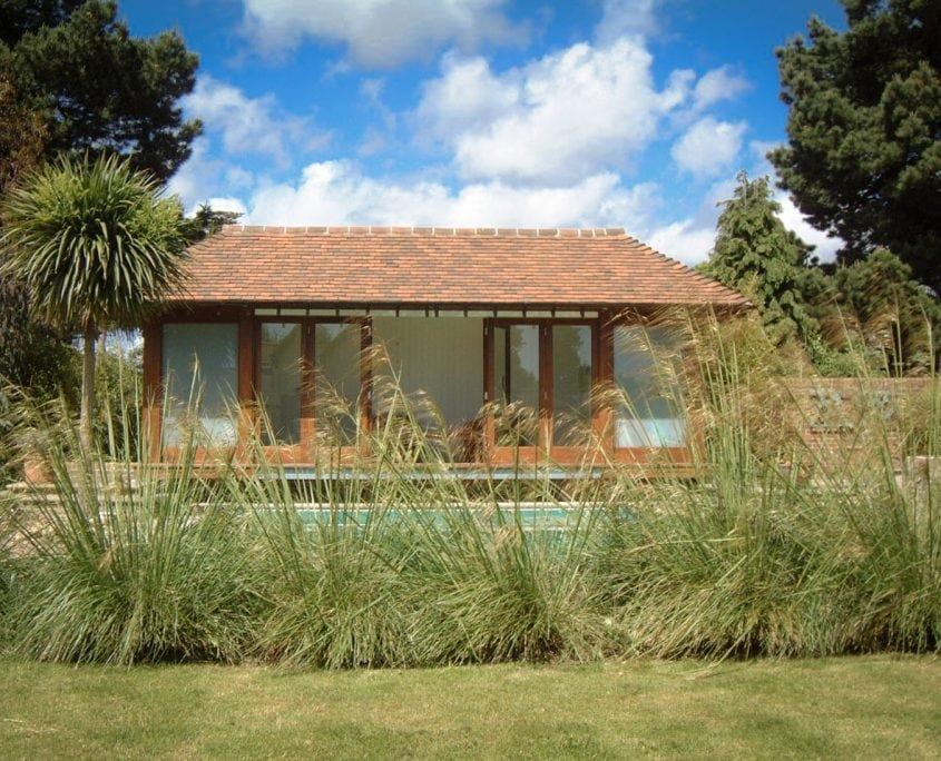 Photo of ornamental grasses with poolhouse west sussex