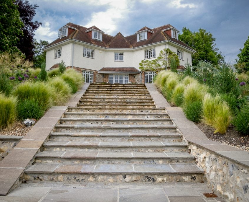 Photo of large country sussex garden with sculpture steps