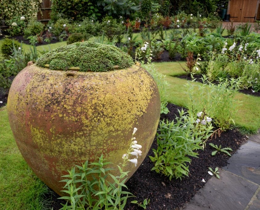 photo of english front garden with rustic containers in sussex