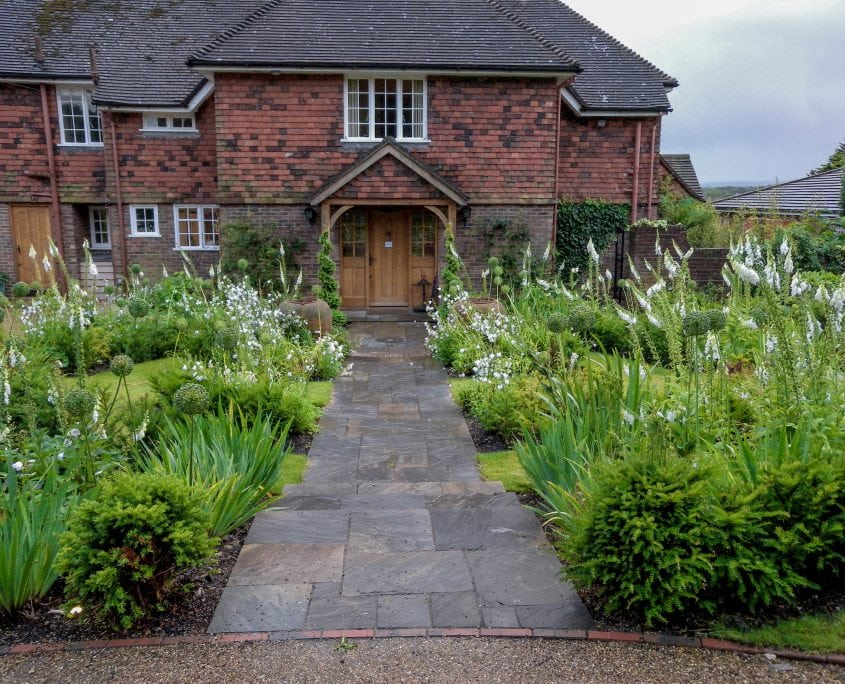 Photo of english front garden with white monochrome planting Sussex