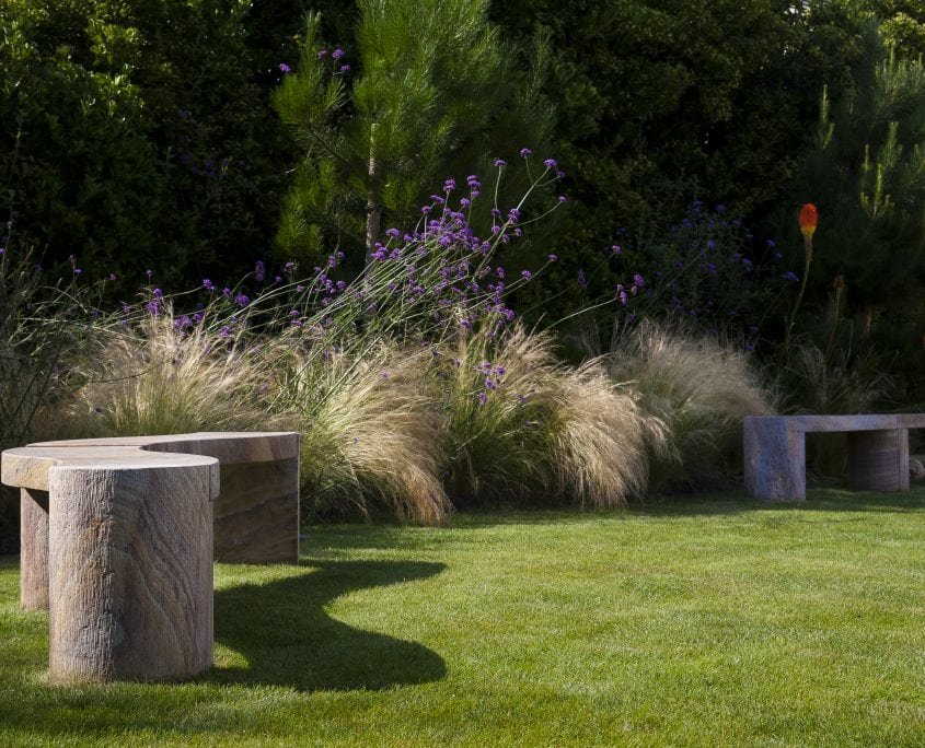 Photo of west sussex contemporary coastal garden design with bespoke sculptural bench