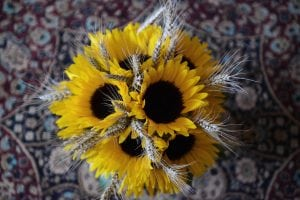 A photo of a Sunflower and barley floristry arrangement