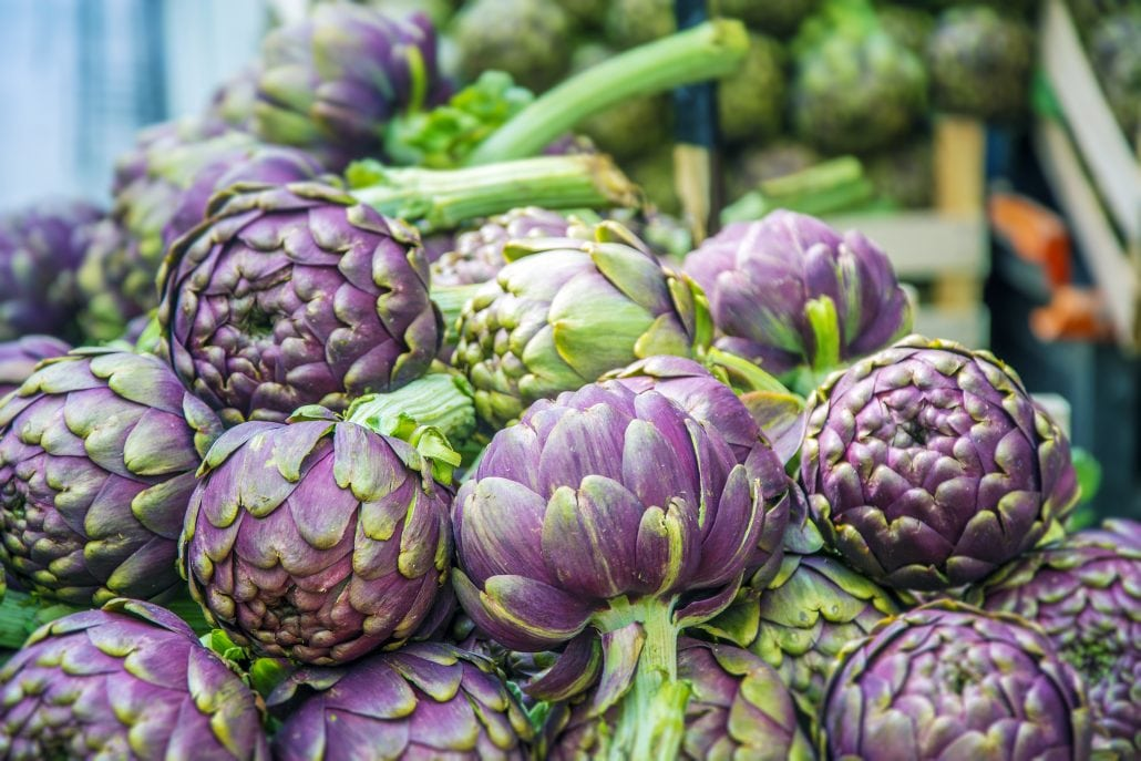 Group of artichokes in a market stall